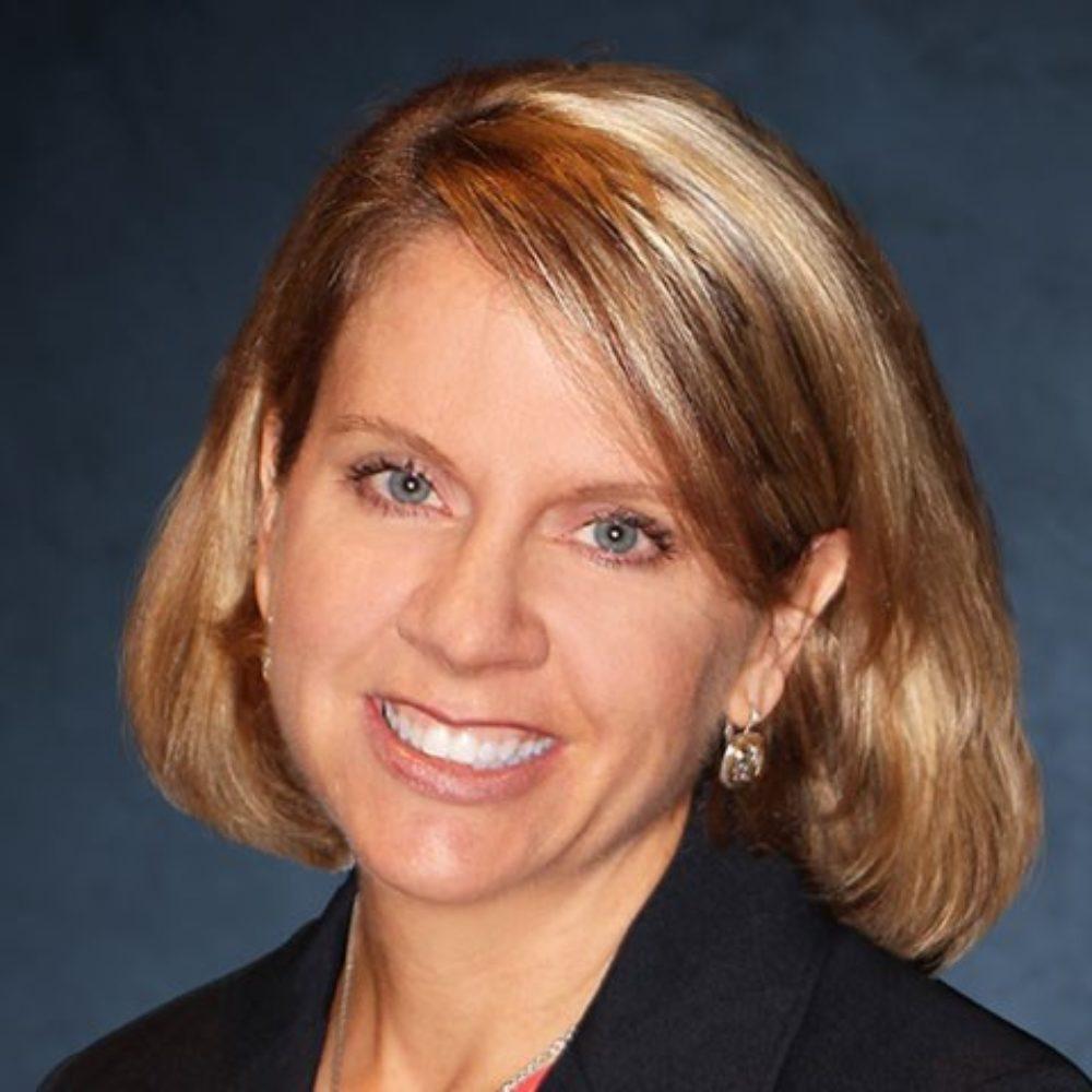A professional headshot of Kendra Waldbusser.